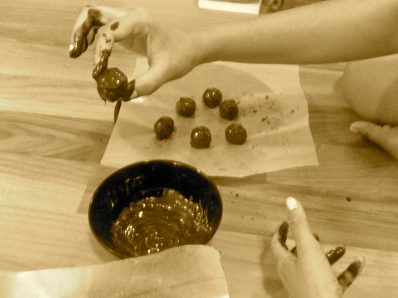 Dipping truffles in chocolate