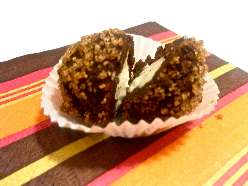 Brown sugar coated chocolate truffle with orange-cream cheese center