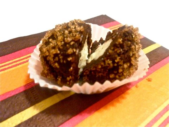 Brown sugar coated chocolate truffle with orange-cream cheese center