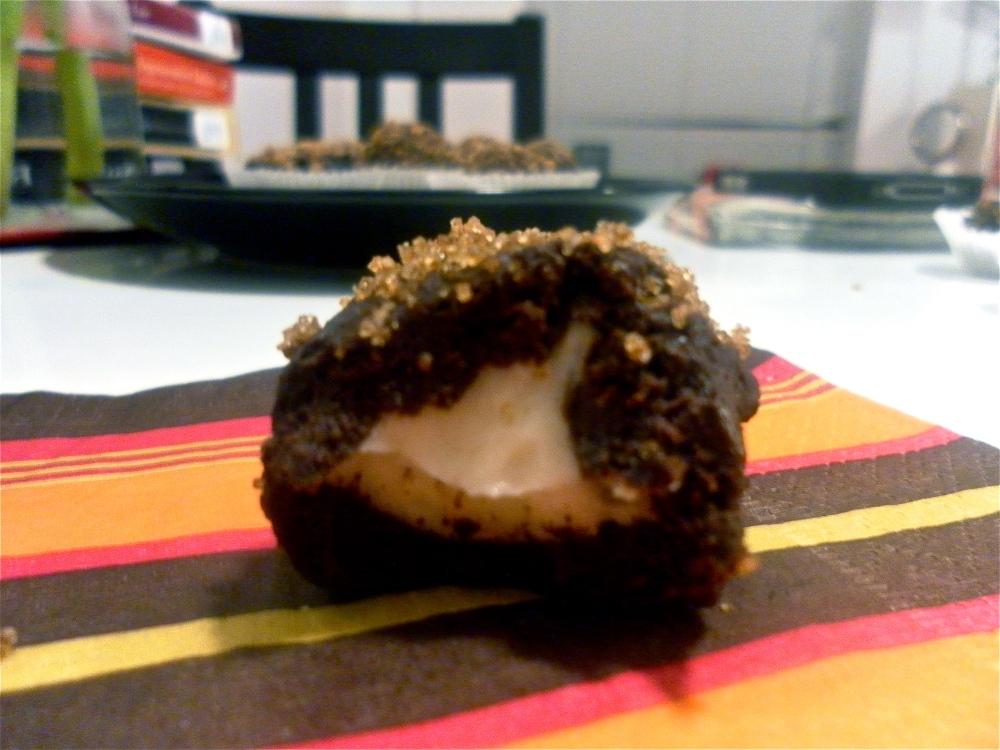 Sugar coated chocolate truffle with orange-cream cheese center