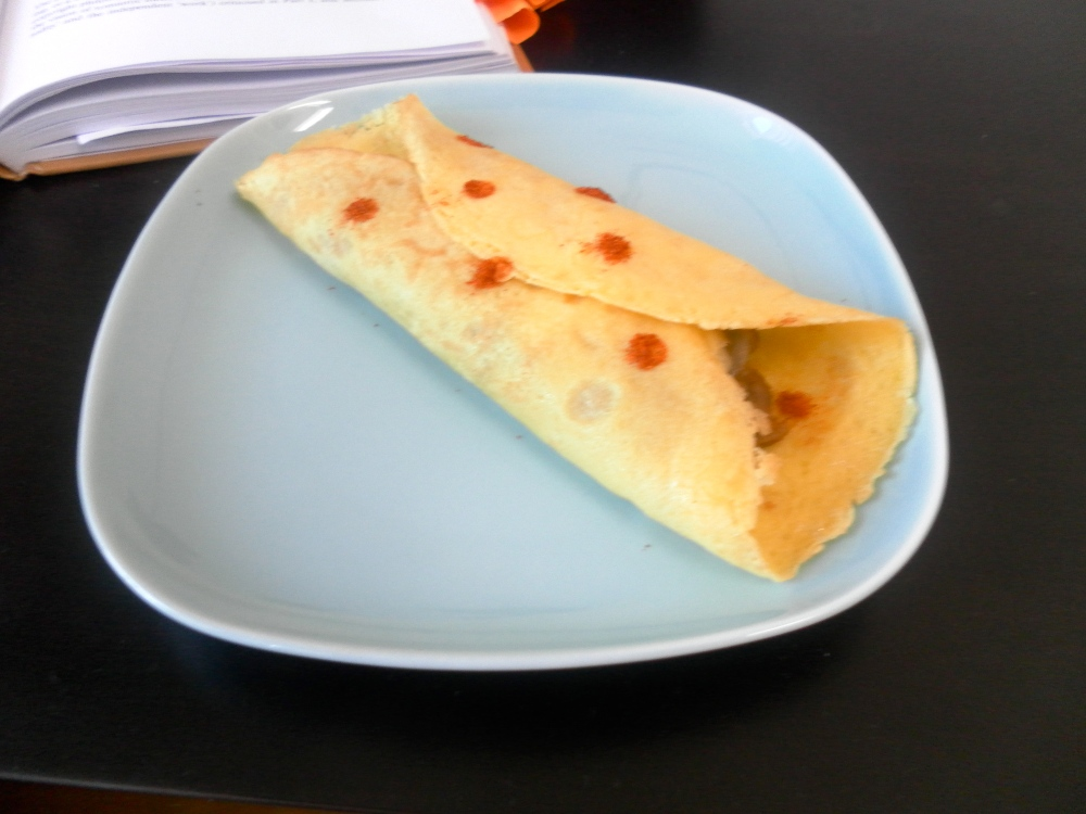 Baked crepes with refried beans and cheese