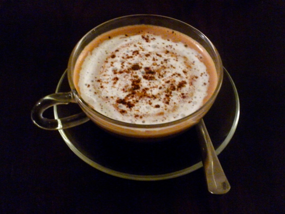 Hazelnut and chocolate coffee whipped cream and a sprinkling of cocoa powder.