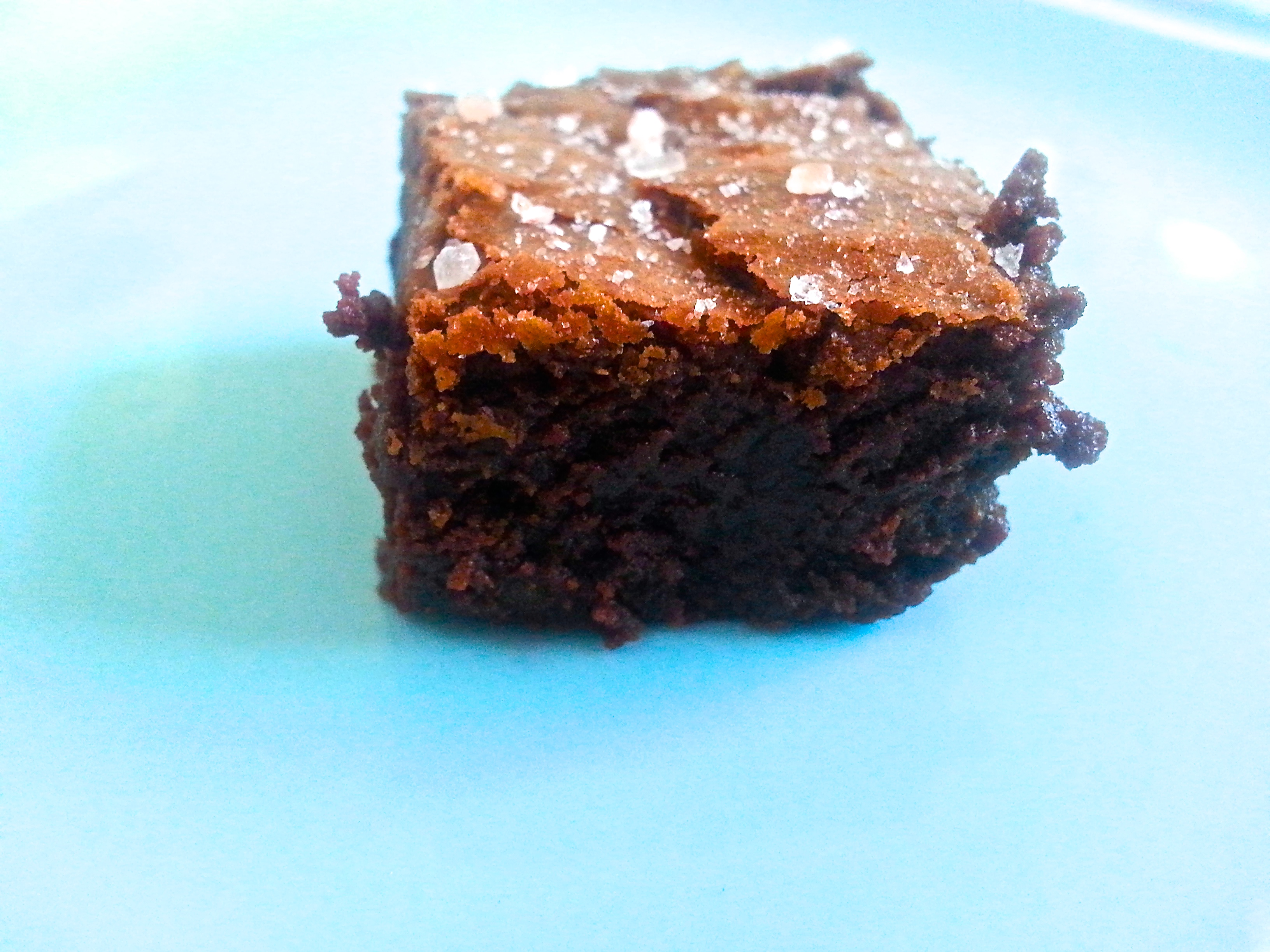 Fudgy Brownies topped with salt flakes