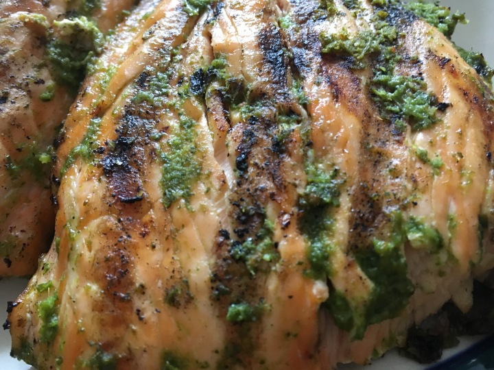 Charred, grilled salmon in spicy green onion marinade
